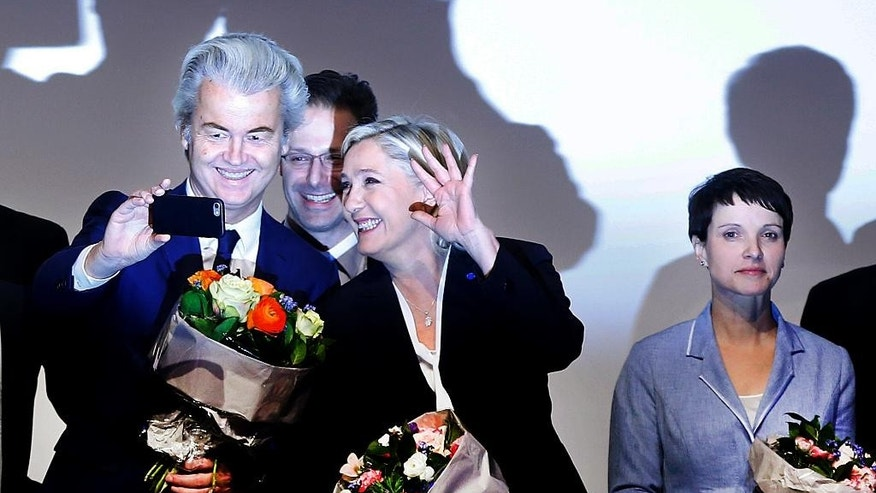 AfD (Alternative for Germany) chairwoman Frauke Petry, right, Far-right leader and candidate for next spring presidential elections Marine le Pen from France, center, and Dutch populist anti-Islam lawmaker Geert Wilders stand together after their speechesat a meeting of European Nationalists in Koblenz, Germany, Saturday, Jan. 21, 2017. (AP Photo/Michael Probst)