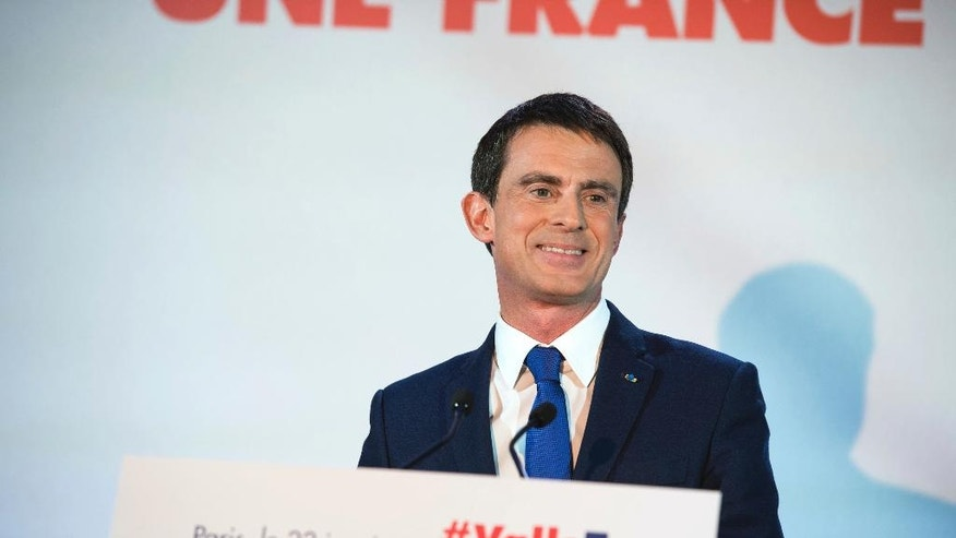 Candidate for the French left's presidential primaries ahead of the 2017 presidential election and former Prime Minister, Manuel Valls, addresses his supporters at his headquarters in Paris, France, Sunday, Jan. 22, 2017. Partial results suggest that Manuel Valls, a center-leaning former prime minister who rallied France together after extremist attacks, will confront stalwart Socialist Benoit Hamon in the country's left-wing presidential primary runoff next week. (AP Photo/Zacharie Scheurer)