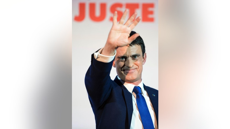Candidate for the French left's presidential primaries ahead of the 2017 presidential election and former Prime Minister, Manuel Valls, waves after addressing his supporters at his headquarters in Paris, France, Sunday, Jan. 22, 2017. Partial results suggest that Manuel Valls, a center-leaning former prime minister who rallied France together after extremist attacks, will confront stalwart Socialist Benoit Hamon in the country's left-wing presidential primary runoff next week. (AP Photo/Zacharie Scheurer)