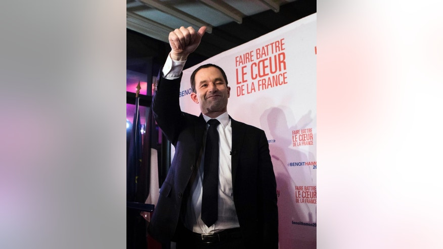 Candidate for the French left's presidential primaries ahead of the 2017 presidential election, Benoit Hamon, gives thumbs up while addressing his supporters at his headquarters in Paris, France, Sunday, Jan. 22, 2017. Partial results suggest that Manuel Valls, a center-leaning former prime minister who rallied France together after extremist attacks, will confront stalwart Socialist Benoit Hamon in the country's left-wing presidential primary runoff next week. (AP Photo/Kamil Zihnnioglu)