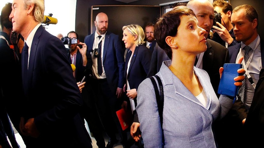 AfD (Alternative for Germany) chairwoman Frauke Petry, right, leaves after a press conference at a meeting of European Nationalists in Koblenz, Germany, Saturday, Jan. 21, 2017. Standing at left is Dutch populist anti-Islam lawmaker Geert Wilders. (AP Photo/Michael Probst)