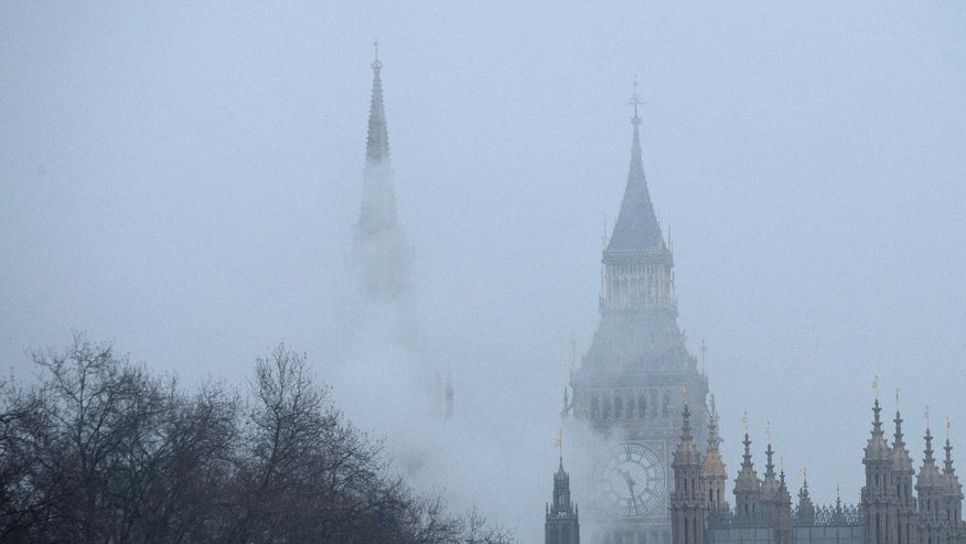 The London landmark known as Big Ben is seen through fog and mist on a foggy day in London, Monday, Jan. 23, 2017. Freezing fog covered the capital on Monday as cold weather conditions continued. (AP Photo/Alastair Grant)