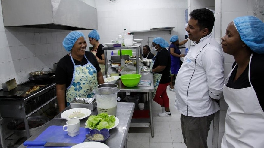 This Jan. 13, 2017 photo show inmates who cook for the Interno restaurant in the kitchen at the San Diego prison, in Cartagena, Colombia. Convicts have been serving up gourmet meals at the Interno in the all-women prison since December, in a novel experiment intended to promote the inmates' rehabilitation and confront the Colombian public's neglect of the country's exploding prison population. (AP Photo/Alba Tobella)