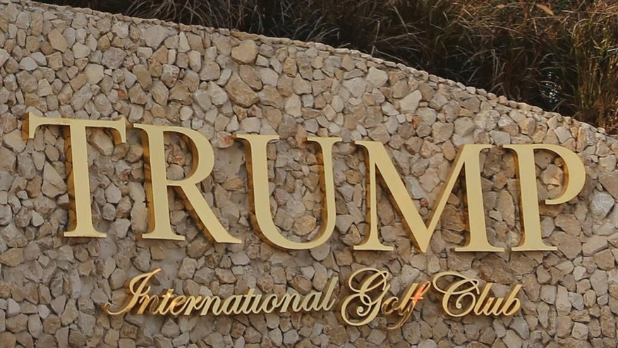 In this Wednesday, Jan. 18, 2017 photo, a sign is seen at the Trump International Golf Club sales center in Dubai, United Arab Emirates. Security experts warn that businesses around the world bearing U.S. President Donald Trump's name face an increased risk now that the businessman is in the White House. (AP Photo/Kamran Jebreili)