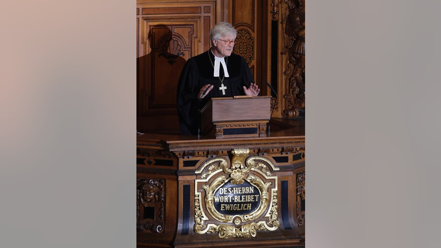 Bishop Heinrich Bedford-Strohm, chair of the Council of the Evangelical Church in Germany, delivers a eulogy during the state funeral of late German President Roman Herzog in the Berlin Cathedral Church in Berlin, Germany, Tuesday, Jan. 24, 2017. Herzog, who was German President between 1994 and 1999, died Jan. 10, 2017. He was 82.  (AP Photo/Ferdinand Ostrop, pool)