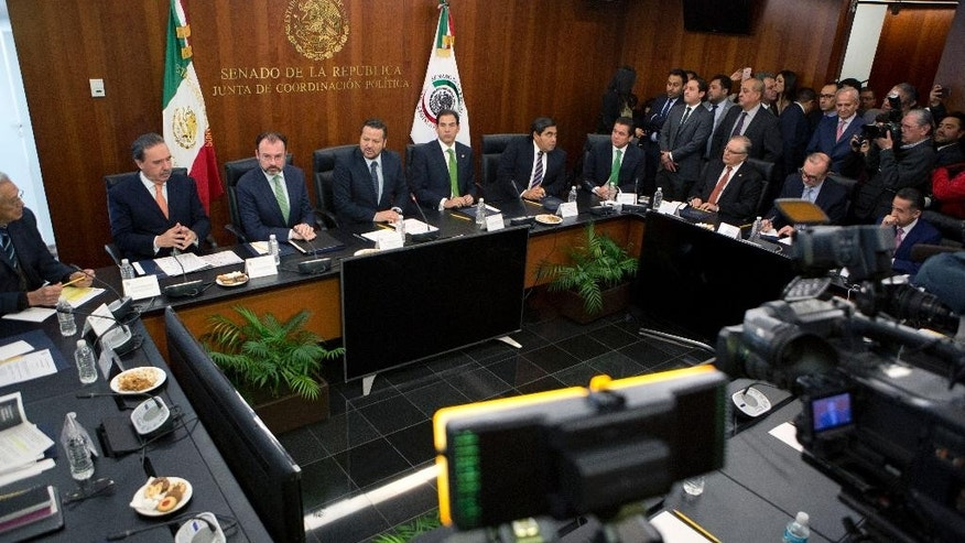 Mexico's Foreign Relations Secretary Luis Videgaray, second left, meets with senators in preparation for a trip to the U.S., where he will participate in talks with members of President Donald Trump's government, in Mexico City, Tuesday, Jan. 24, 2017. Among the participating senators were Fernando Herrera Avila, center, and Pablo Escudero Morales, center right. (AP Photo/Rebecca Blackwell)