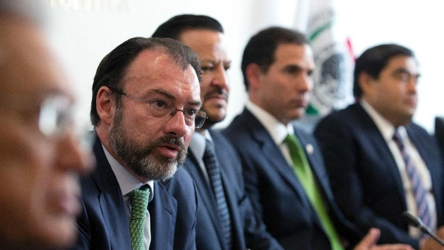 Mexico's Foreign Relations Secretary Luis Videgaray, second left, speaks to the press after meeting with Mexican senators in preparation for a trip to the U.S., where he will participate in talks with members of President Donald Trump's government, in Mexico City, Tuesday, Jan. 24, 2017. Seated beside him are senators Fernando Herrera Avila, center, and Pablo Escudero Morales, second right.(AP Photo/Rebecca Blackwell)