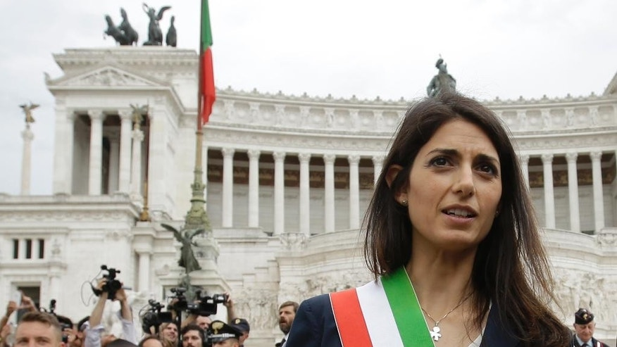 "FILE - In this Thursday, June 23, 2016 filer, Rome's Mayor Virginia Raggi leaves the Rome's Vittoriano Unknown soldier monument after laying a wreath. Prosecutors are seeking to question Rome's embattled mayor over one of several problematic appointments that have tarnished her young administration and Italy's populist 5-Star Movement. In a Facebook post Tuesday, Jan. 24, 2017 Mayor Virginia Raggi confirmed the investigation, said she had ""complete faith"" in prosecutors and was prepared to provide them with all clarifications. (AP Photo/Gregorio Borgia, File)"