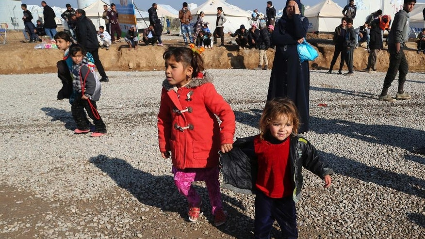 Displaced Iraqis, who fled fighting between Iraqi security forces and Islamic State militants, prepare to leave Hassan Sham camp, east of Mosul, Iraq, Monday, Jan. 23, 2017. Hundreds of families are moving back to Mosul after the Iraqi security forces retook much of the city's eastern half from Islamic State militants. (AP Photo/ Khalid Mohammed)