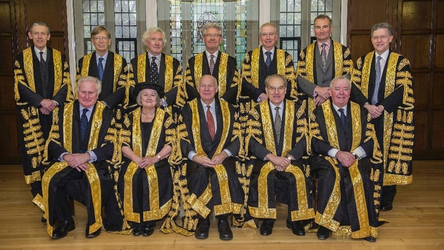 This undated photo issued by the Supreme Court shows the Justices of the Supreme Court of the UK who will be sitting on the Article 50 case on Tuesday Jan. 24, 201. Back row from left, Lord Toulson - not sitting in the Article 50 case -, Lord Carnwath, Lord Sumption, Lord Wilson, Lord Reed, Lord Hughes, Lord Hodge and front row from left, Lord Kerr, Lady Hale, Lord Neuberger, Lord Mance, Lord Clarke. Britain's government must get parliamentary approval before starting the process of leaving the European Union, the Supreme Court ruled Tuesday Jan. 24, 2017, potentially delaying Prime Minister Theresa May's plans to trigger negotiations by the end of March. (Supreme Court via AP)