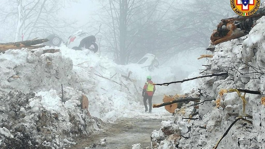 This picture made available on Tuesday, Jan. 24, 2017 by the Italian Mountain Rescue Service 'Corpo Nazionale Soccorso Alpino e Speleologico' (CNSAS) shows a cleared pathway by the site of the avalanche-buried Hotel Rigopiano, near Farindola. Italy. The death toll from an avalanche in central Italy climbed to 14 on Tuesday as hopes began to fade that any of the 15 people still missing might be found alive under a mountain resort buried by tons of snow and rubble. (Corpo Nazionale Soccorso Alpino e Speleologico/ANSA via AP)