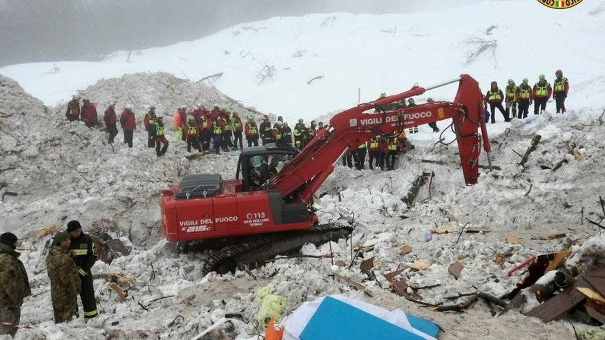 This picture made available on Tuesday, Jan. 24, 2017 by the Italian Mountain Rescue Service 'Corpo Nazionale Soccorso Alpino e Speleologico' (CNSAS) shows an excavator at the site of the avalanche-buried Hotel Rigopiano, near Farindola. Italy. The death toll from an avalanche in central Italy climbed to 14 on Tuesday as hopes began to fade that any of the 15 people still missing might be found alive under a mountain resort buried by tons of snow and rubble. (Corpo Nazionale Soccorso Alpino e Speleologico/ANSA via AP)