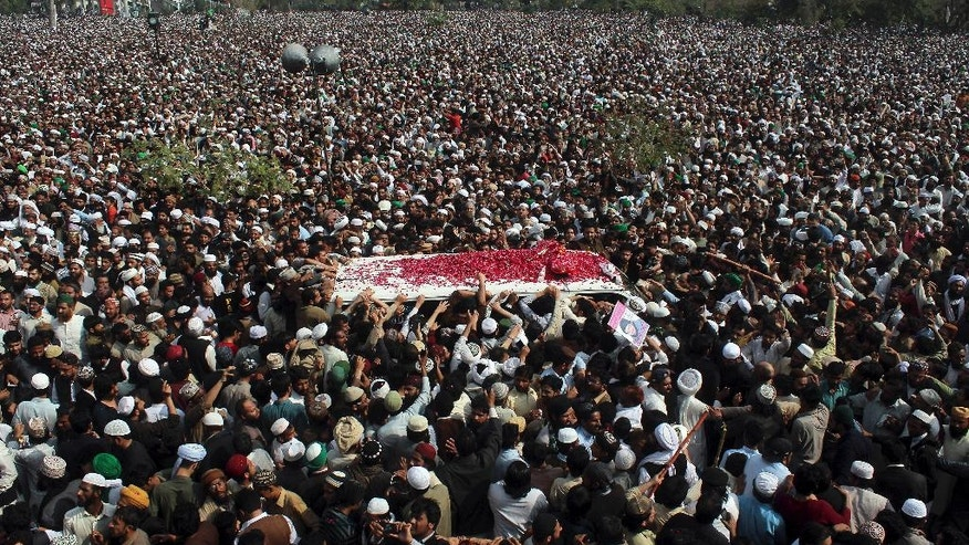 FILE - In this Tuesday, March 1, 2016, file photo, thousands of people attend the funeral of Mumtaz Qadri who was hanged for gunning down a politician who criticized the country's blasphemy law, in Rawalpindi, Pakistan. Pakistan's controversial blasphemy law which demands death to anyone accused of insulting Islam or its prophet has been a rallying cry for extremist groups who threaten violence at any attempt to prevent abuses, never mind repeal it. (AP Photo/Anjum Naveed, File)