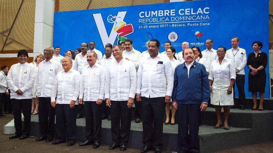 Heads of state pose for the official photo of the V Summit of the Community of Latin American and Caribbean States in Bavaro, Dominican Republic, Wednesday, Jan. 25, 2017. (AP Photo/Tatiana Fernandez)