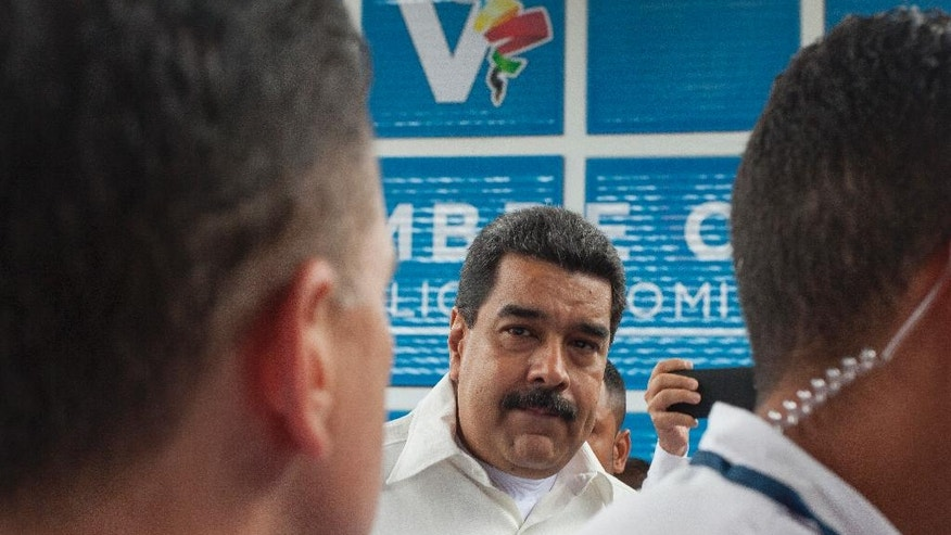 Venezuelan President Nicolas Maduro speaks to the press before entering the V Summit of the Community of Latin American and Caribbean States, in Bavaro, Dominican Republic, Wednesday, Jan. 25, 2017. (AP Photo/Tatiana Fernandez)