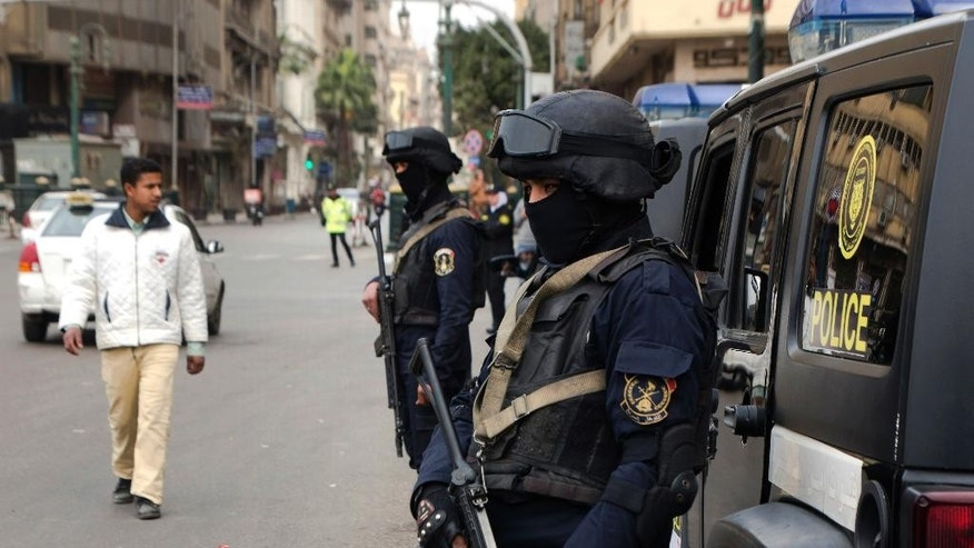 Policemen from the rapid deployment forces stand alert at Tahrir Square, the focal point of the Egyptian uprising, in Cairo, Egypt, Wednesday, Jan. 25, 2017. Egypt on Wednesday marked the sixth anniversary of the popular uprising that toppled longtime autocrat Hosni Mubarak but failed to bring the country the democracy and freedom the young, pro-democracy youths who fueled it had dreamt of. (AP Photo/Amr Nabil)