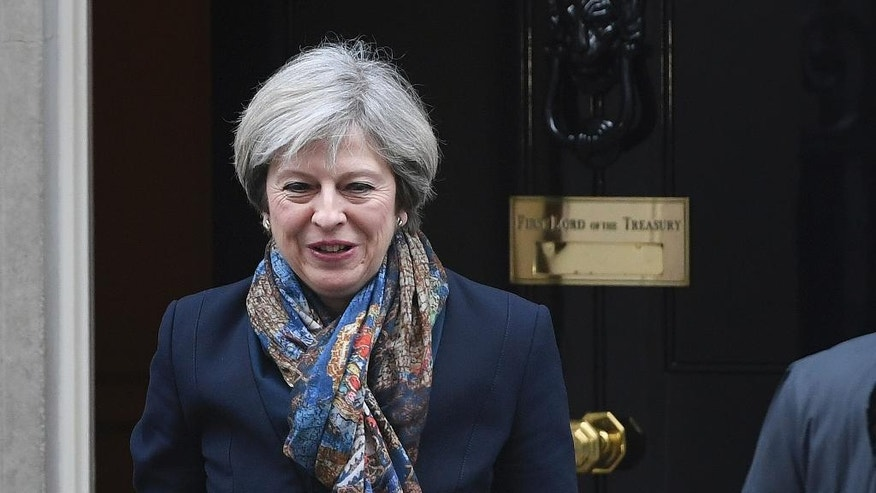 Britain's Prime Minister, Theresa May, leaves Downing Street in London Tuesday Jan. 24, 2017. Britain's government must get parliamentary approval before starting the process of leaving the European Union, the Supreme Court ruled Tuesday, potentially delaying Prime Minister Theresa May's plans to trigger exit negotiations by the end of March.  (Victoria Jones/PA via AP)