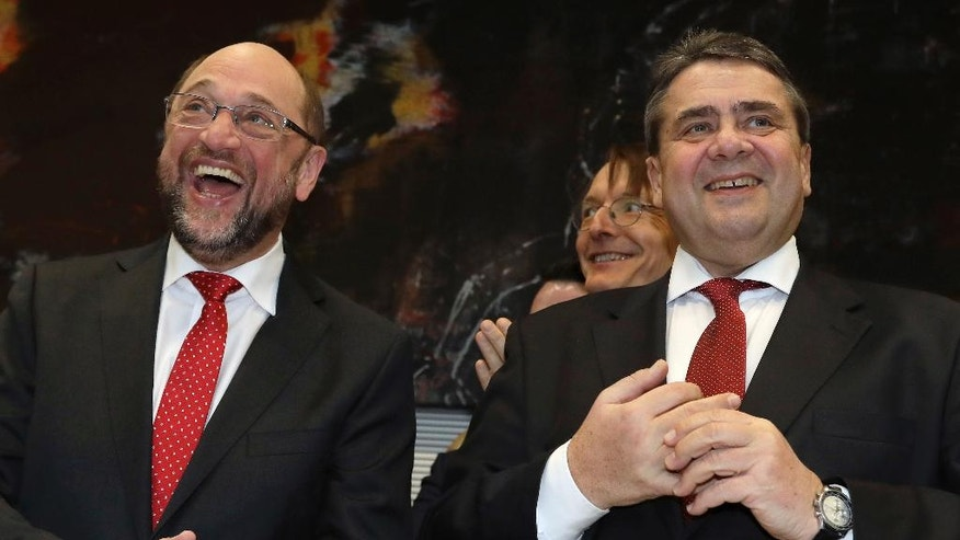 Sigmar Gabriel, current chairman of the German Social Democratic Party, SPD, right, and SPD politician and designated party's chairman Martin Schulz, left, laugh as they arrive for a faction meeting of the German Social Democrats at the Reichstag building, host of the German federal parliament, Bundestag, in Berlin, Germany, Wednesday, Jan. 25, 2017. (AP Photo/Michael Sohn)