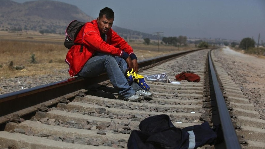 Mario Vazquez Santiago, a migrant from Guatemala, waits for a northbound train on the outskirts of Mexico City, Wednesday, Jan. 25, 2017. President Donald Trump signed two executive orders on Wednesday to jumpstart construction of a U.S.-Mexico border wall and strip funding for so-called sanctuary cities, which don't arrest or detain immigrants living in the U.S. illegally. (AP Photo/Marco Ugarte)