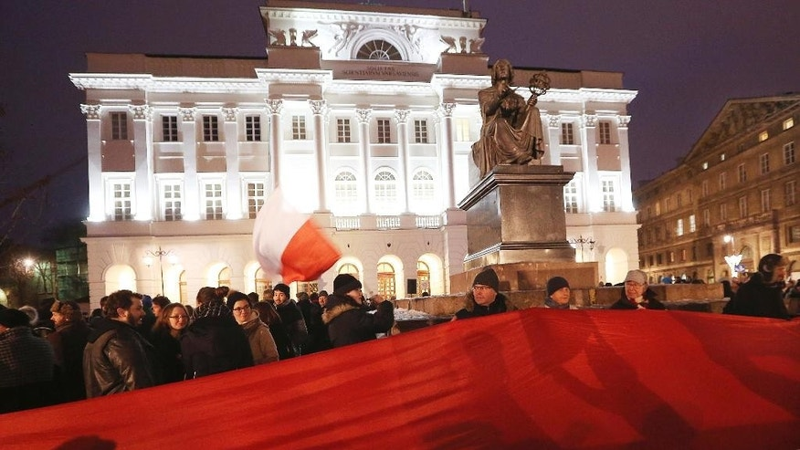 Students protest in front of the Copernicus monument in Warsaw, Poland, Wednesday, Jan. 25, 2017. Hundreds of students gathered Wednesday in Warsaw and other Polish cities to protest the country's populist and nationalist government, with a range of demands that includes better ties with the European Union and protecting the environment. (AP Photo/ Czarek Sokolowski)