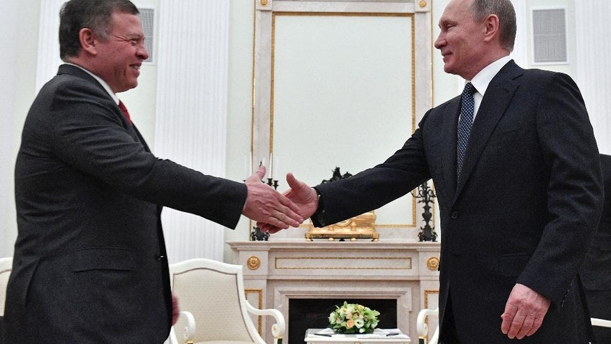 Russian President Vladimir Putin, right, shakes hands with Jordan's King Abdullah II during their meeting in the Kremlin in Moscow, Russia, Wednesday, Jan. 25, 2017. (Alexander Nemenov/Pool Photo via AP)