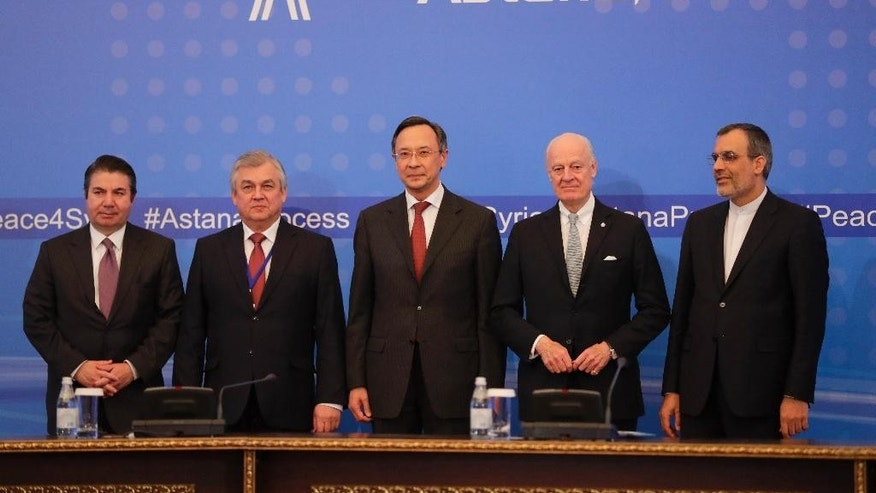 From left, Turkish Foreign Ministry Deputy Undersecretary Sedat Onal, Russia's special envoy on Syria Alexander Lavrentiev, Kazakh Foreign Minister Kairat Abdrakhmanov, UN Syria envoy Staffan de Mistura and Iran's Deputy Foreign Minister Hossein Jaber Ansari pose for a photo after the final statement following the talks on Syrian peace in Astana, Kazakhstan, Tuesday, Jan. 24, 2017. Russia, Iran and Turkey _ sponsors of talks in Kazakhstan between Syria and rebel factions _ pledged Tuesday to consolidate the country's nearly month-old cease-fire and set up a three-way mechanism to ensure compliance of all sides. (AP Photo/Sergei Grits)
