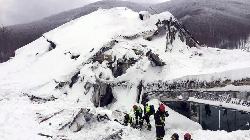 FILE - In this Thursday, Jan. 19, 2017 file photo, Italian firefighters search for survivors after an avalanche buried Hotel Rigopiano near Farindola, central Italy. The final death toll from Italy's devastating avalanche stands at 29 after the remaining bodies were pulled out of the rubble of the hotel crushed by tons of snow, firefighters said Thursday, Jan. 26. Firefighters issued the update after a week of search efforts at the isolated hotel. Nine people were pulled out alive in the first days of the rescue. (Italian Firefighters/ANSA via Italian Firefighters, File)