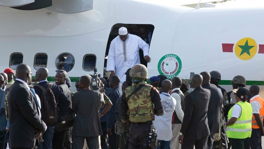 Gambian President Adama Barrow, disembarks a plane as he arrives at Banjul airport in Gambia, Thursday Jan. 26, 2017, after flying in from Dakar, Senegal. Gambia's new president has finally arrived in the country, a week after taking the oath of office abroad amid a whirlwind political crisis. Here's a look at the tumble of events that led to Adama Barrow's return — and the exile of the country's longtime leader.  (AP Photo/Jerome Delay)