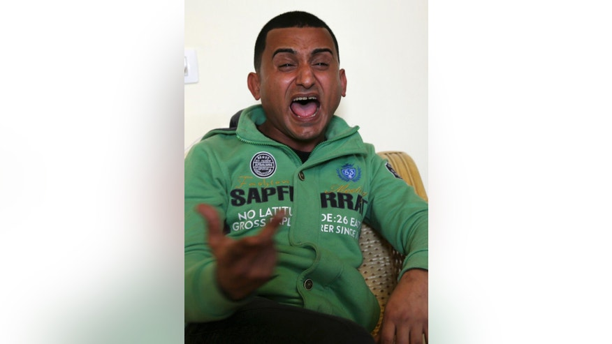 "Gaza comedian Adel al-Mashwakhi gestures while singing during an interview with The Associated Press office in Gaza City, Thursday, Jan. 26, 2017. Gaza's Hamas rulers have released al-Mashwakhi who was arrested two weeks ago for posting a Facebook video lamenting hardships under its rule. Adel al-Mashwakhi says he was released on bail on Wednesday on the condition that he does not make any more ""politically flavored"" works or discuss the conditions in which he was held. (AP Photo/Adel Hana)"