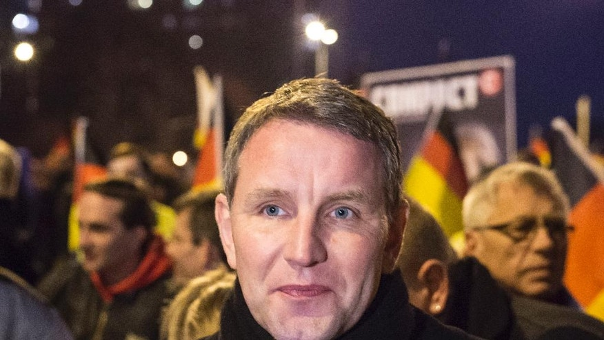 FILE - In this March 16, 2016 file photo Bjoern Hoecke, chairman of the Alternative fuer Deutschland (AfD) in the German state of Thuringia, leads the rally in Erfurt, central Germany. Hoecke plans to attend a memorial ceremony in the Buchenwald Nazi concentration camp on Holocaust Rememberance Day on Jan. 27, 2017 despite being to welcomed there.  (AP Photo/Jens Meyer, file)