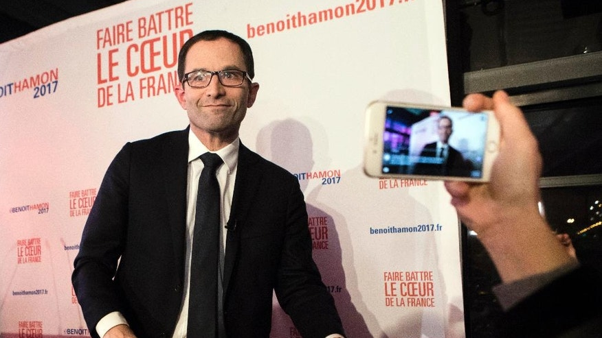 Candidate for the French left's presidential primaries ahead of the 2017 presidential election, Benoit Hamon, addresses his supporters at his headquarters in Paris, France, Sunday, Jan. 22, 2017. Partial results suggest that Manuel Valls, a center-leaning former prime minister who rallied France together after extremist attacks, will confront stalwart Socialist Benoit Hamon in the country's left-wing presidential primary runoff next week. (AP Photo/Kamil Zihnnioglu)