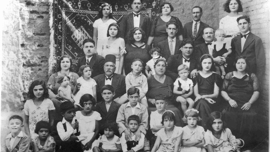 In this 1939 handout photo, provided by Tales of Jewish Sudan, Farag Shoua, center row wearing a Fez, a Jewish migrant and merchant from Egypt, sits with his extended family at an engagement party in Khartoum, Sudan. The expansion of commerce and the civil service under Anglo-Egyptian colonial rule brought some Jewish merchants and administrators from other parts of the Middle East and North Africa. Sudan's tight-knit Jewish community grew to about 1,000 people at its peak. (Photo courtesy of Daisy Abboudi via AP).