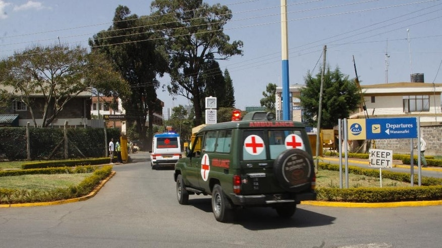 Bodies of Kenyan soldiers are transported by ambulances as they arrive at Wilson airport, Nairobi Kenya, Friday Jan 27, 2017. A spokesman for extremist group al-Shabab says its fighters have killed at least 51 Kenyan soldiers in an attack on an army base in Kulbiyow, a town in Lower Jubba region. (AP Photo/Khalil Senosi)
