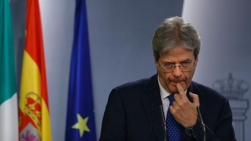 Italy's Premier Paolo Gentiloni pauses during a joint news conference with Spain's Prime Minister Mariano Rajoy at the Moncloa Palace in Madrid, Spain, Friday Jan. 27, 2017. (AP Photo/Francisco Seco)