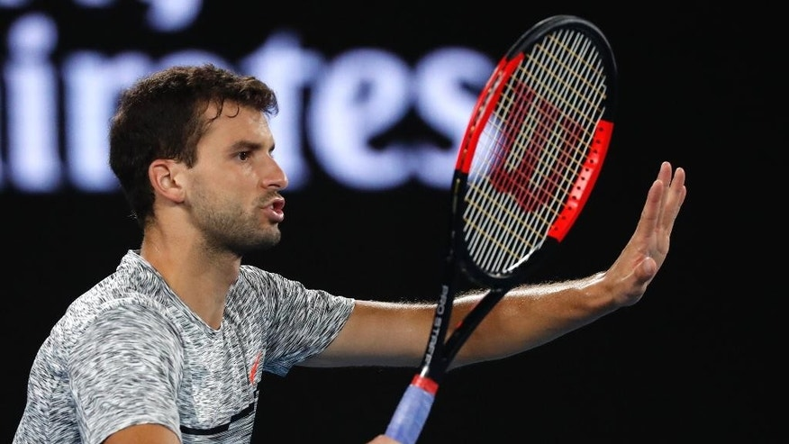 Bulgaria's Grigor Dimitrov gestures during his semifinal against Spain's Rafael Nadal at the Australian Open tennis championships in Melbourne, Australia, Friday, Jan. 27, 2017. (AP Photo/Kin Cheung)