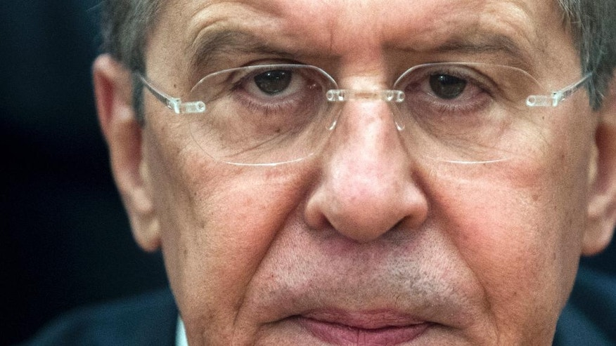 Russian Foreign Minister Sergey Lavrov attends a meeting with Syria's opposition members in Moscow, Russia, Friday, Jan. 27, 2017. Lavrov said at the start of his Friday's meeting that the negotiations previously set for Feb. 8 have been postponed until the end of the month. He didn't elaborate on reasons behind the delay. (AP Photo/Pavel Golovkin)