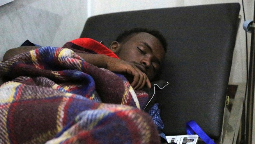 In this Jan. 2, 2017 photo, an Ethiopian migrant lies on a bed at International Organization of Migration center in the port city of Aden, Yemen. Despite Yemen's civil war, migrants from Ethiopia and Saudi Arabia are streaming in, hoping to make their way to wealthy Saudi Arabia. Instead, they often meet torture, rape and imprisonment at the hands of smugglers.(AP Photo/Maad Al-Zikry)