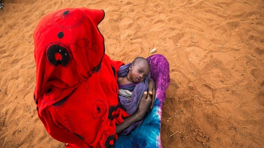 Sara Alisio and her one-month old child Molide Kelbi wait for food and water in the Warder district in the Somali region of Ethiopia, Saturday, Jan. 28, 2017. Ethiopia is struggling to counter a new drought in its east that authorities say has left 5.6 million people in urgent need of assistance. (AP Photo/Mulugeta Ayene)