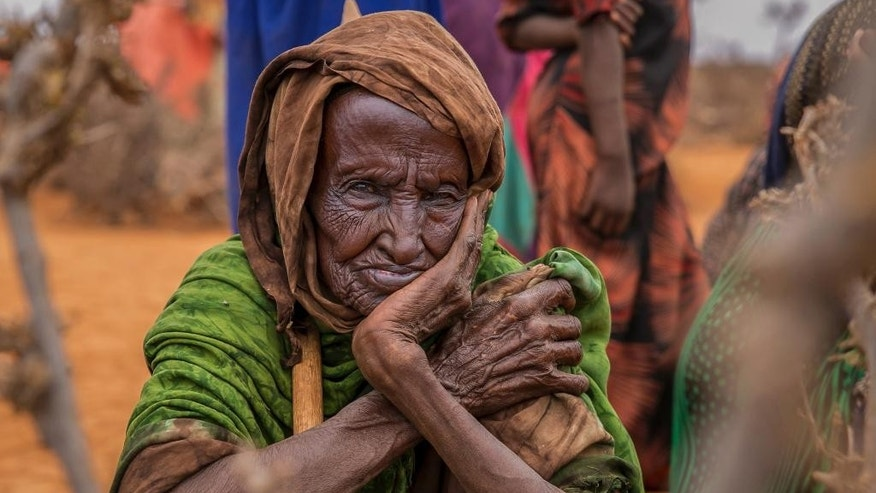 An elderly women waits for food aid in the Warder district in the Somali region of Ethiopia, Saturday Jan. 28, 2017. Ethiopia is struggling to counter a new drought in its east that authorities say has left 5.6 million people in urgent need of assistance. (AP Photo/Mulugeta Ayene)