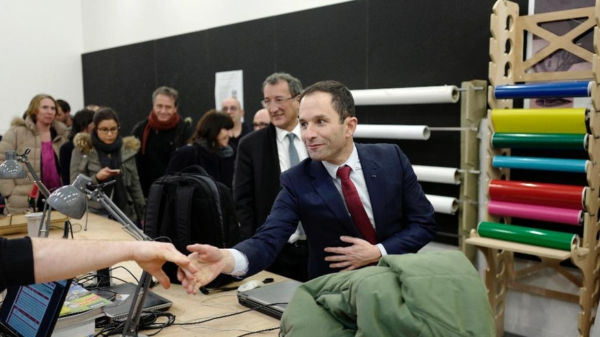 Candidate for the left-wing presidential primaries Benoit Hamon visits a cultural center in Lille, Northern France, Friday, Jan. 27, 2017. Manuel Valls, a center-leaning former prime minister who rallied France together after extremist attacks, will confront stalwart Socialist Benoit Hamon in the country's left-wing presidential primary runoff Sunday. (AP Photo/Michel Spingler)
