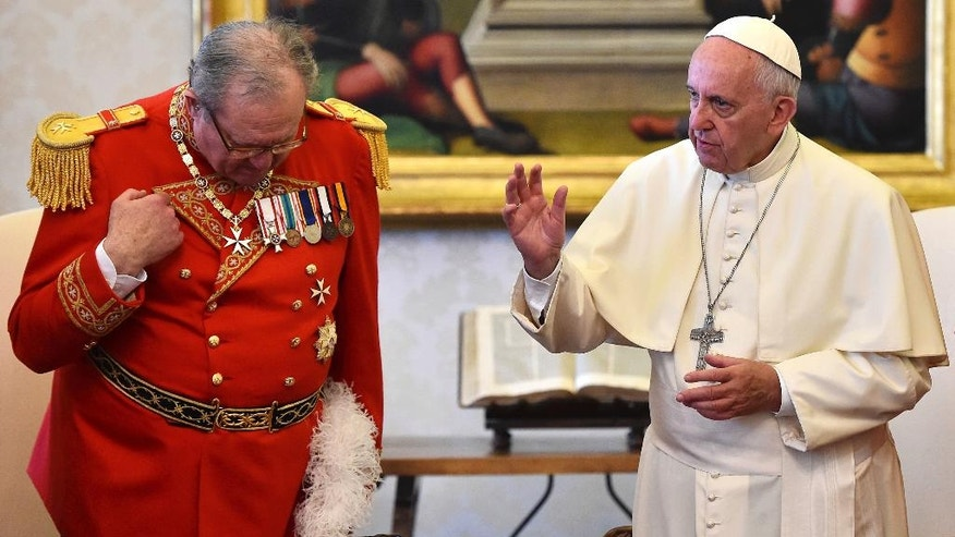 "FILE - In this June 23, 2016 file photo, Pope Francis delivers his blessing during his meeting with Grand Master of the Knights of Malta Matthew Festing, left, at the Vatican. The Knights of Malta is still insisting on its sovereignty in its showdown with the Vatican, even after Pope Francis effectively took control of the ancient religious order and announced a papal delegate would govern it through a ""process of renewal."" ( Gabriel Bouys/ Pool Photo via AP, files)"
