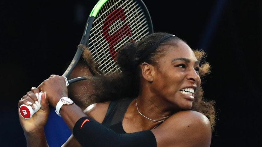 United States' Serena Williams follows through on a backhand return to her sister Venus during the women's singles final at the Australian Open tennis championships in Melbourne, Australia, Saturday, Jan. 28, 2017. (AP Photo/Kin Cheung)