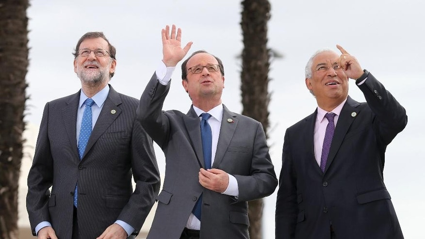 Spain's Prime Minister Mariano Rajoy, France's President Francois Hollande and Portuguese Prime Minister Antonio Costa, from left, pose for a group photo at Lisbon's Belem Cultural Center Saturday, Jan. 28 2017. The leaders of France, Italy, Spain, Greece, Portugal, Malta and Cyprus are attending an informal summit of southern European Union countries. (AP Photo/Armando Franca)