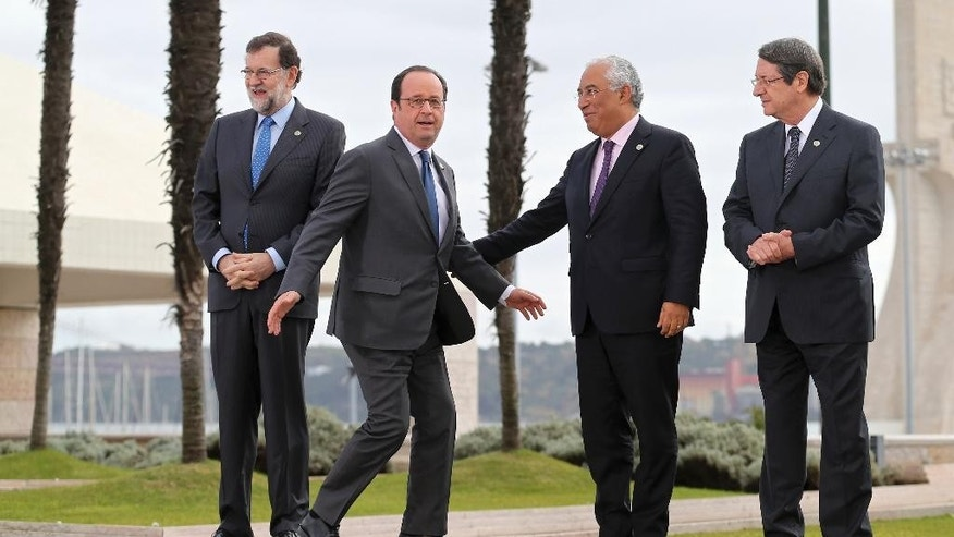 France's President Francois Hollande, 2nd left, joins Spain's Prime Minister Mariano Rajoy, left, Portuguese Prime Minister Antonio Costa, and Malta's Prime Minister Joseph Muscat, right, for a group photo at Lisbon's Belem Cultural Center Saturday, Jan. 28 2017. The leaders of France, Italy, Spain, Greece, Portugal, Malta and Cyprus are attending an informal summit of southern European Union countries. (AP Photo/Armando Franca)