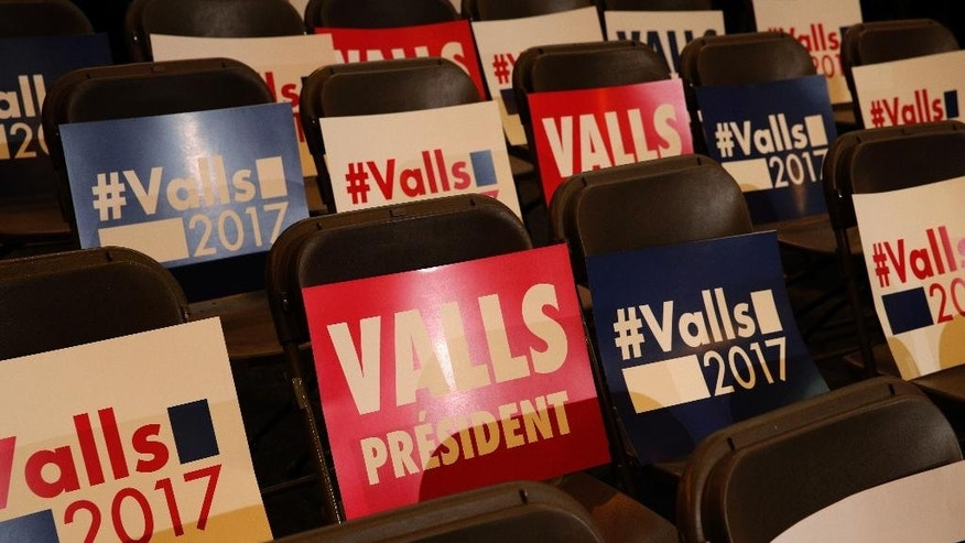 Posters are set up on chairs before the meeting of former French prime minister and candidate in the left-wing primary for the 2017 French presidential election, Manuel Valls, in Alfortville, outside Paris, France, Thursday, Jan. 26, 2017. Former education minister Benoit Hamon will take on former prime minister Manuel Valls in a run-off vote on January 29, 2017, after scoring a surprise win in the first round of a primary seen as a battle for the party's soul. (AP Photo/Christophe Ena)