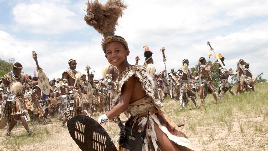 A young boy joins members of the Shembe Church wearing leopard skins during their dance celebrations at eBuhleni, near Durban, South Africa, Sunday, Jan 29, 2017. At least 1,200 men in ceremonial attire have danced at a mainly Zulu gathering wearing a mix of hides of illegally hunted leopards and Chinese-made, spotted capes designed by conservationists to reduce demand for the real thing. (AP Photo/Khaya Ngwenya)