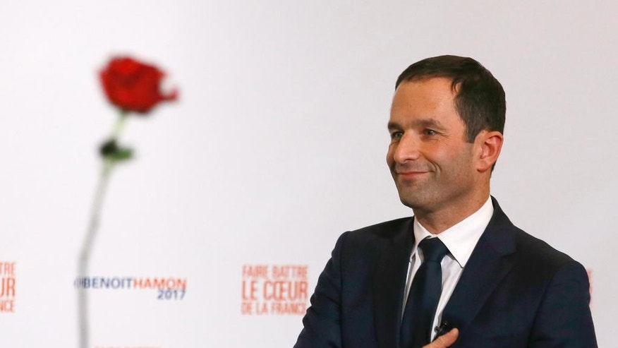Candidate for the French left's presidential primaries Benoit Hamon greets supporters after winning the socialist party presidential nomination in Paris, France, Sunday, Jan. 29, 2017. Partial count shows hard-left candidate Benoit Hamon winning Socialist presidential nomination, beating former French Prime Minister Manuel Valls. (AP Photo/Francois Mori)