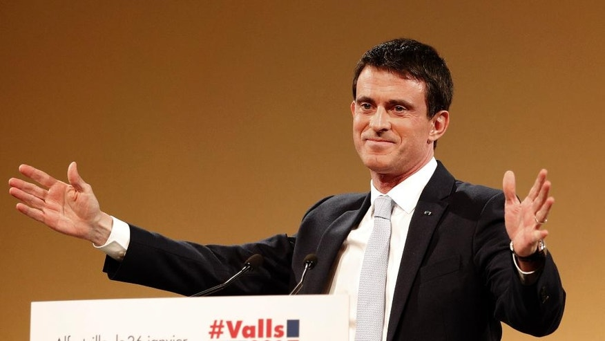 Former French prime minister and candidate in the left-wing primary for the 2017 French presidential election, Manuel Valls, arrives for a meeting in Alfortville, outside Paris, France, Thursday, Jan. 26, 2017. Former education minister Benoit Hamon will take on former prime minister Manuel Valls in a run-off vote on January 29, 2017, after scoring a surprise win in the first round of a primary seen as a battle for the party's soul. (AP Photo/Christophe Ena)