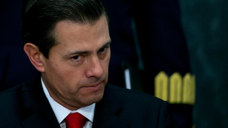 In this Jan. 23, 2017 photo, Mexico's President Enrique Pena Nieto makes a pause during a press conference at the Los Pinos presidential residence in Mexico City. Mexico says President Enrique Pena Nieto has talked with Canadian Prime Minister Justin Trudeau about the North American Free Trade Agreement ahead of planned meetings with U.S. President Donald Trump. (AP Photo/Marco Ugarte)