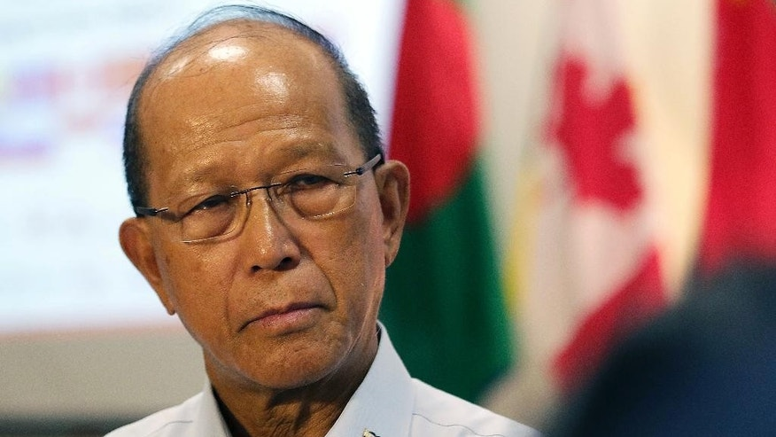 FILE - In this Jan. 25, 2017 file photo, Philippine Defense Secretary Delfin Lorenzana speaks to reporters on the sidelines of the Exercise Coordinated Response (Ex COORES), a multinational Humanitarian Assistance and Disaster Relief table-top exercise with participants from militaries from the Asia-Pacific region, and observers from international, governmental and non-governmental organizations, in Singapore. The Philippines, the only U.S. defense treaty ally among the six claimants in the South China Sea, said the U.S. military will soon commence construction of facilities to accommodate troops and equipment inside Philippine army bases. China has criticized the U.S. military presence in the Philippines. Lorenzana said that President Rodrigo Duterte, who has had a testy relationship with Washington and has mended ties with Beijing, was aware of the impending construction. (AP Photo/Wong Maye-E, File)